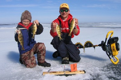 Reel Action Ice Fishing Guide Service for ice fishing Door County Wisconsin for perch, northern pike and walleye on Lake Michigan in Green Bay and Sturgeon Bay Wisconsin.